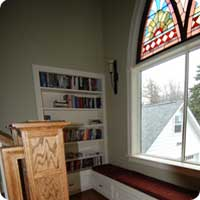 Built in bookcase and window seat storage