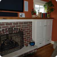 Reclaimed oak fireplace mantel and matching cabinets