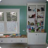 Boys room window seat and bookcase
