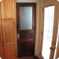 Water closet custom raised panel walnut door