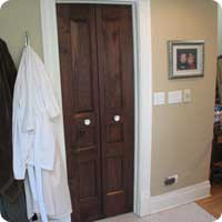 Bi-fold custom raised panel walnut door