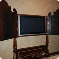 TV cabinet designed to match the bed's headboard